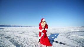 Santa Forgot a Bag With Gifts. Travel Santa on Lake Baikal stock footage