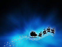 Santa in front of blue glowing rays. Royalty Free Stock Photography