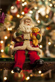 Santa in front of a Christmas tree Royalty Free Stock Photo