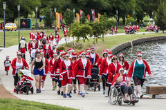 Santa fun run Canberra on Sunday 1 December 2013. Hundreds of men, women and children, many with pets, took part in the 2nd Variety Santa fun run Canberra on Royalty Free Stock Photography