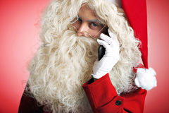 Santa with gadgets in hands Stock Images