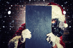 Santa with gas mask royalty free stock photos