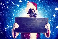 Santa with gas mask stock photos