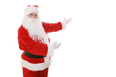 Santa Gestures. Santa Claus gesturing toward an area of copy space.  Isolated design element Stock Photo