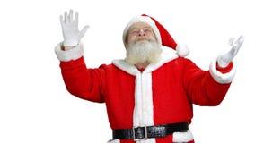 Santa is gesturing and looking up. stock video footage
