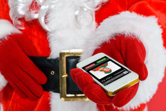 Santa getting a phonecall. Santa Claus or Father Christmas getting a phone call from his Chief Elf on Christmas Eve Royalty Free Stock Photography