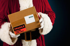 Santa: Getting Ready to Ship Package Royalty Free Stock Photos