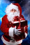 Santa with a gift stock photos