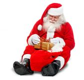Santa with a gift Royalty Free Stock Photos