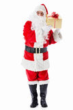 Santa with a gift. Santa Claus with a gift on a white background Stock Image