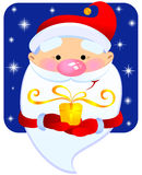 Santa with a gift. Cheerful Santa Claus with a gift Royalty Free Stock Image