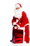 Santa with gift bag and wine Stock Images