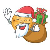 Santa with gift oat cookie isolated with the cartoon. Vector illustration stock illustration