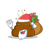 Santa with gift Poop emoticon character cartoon Stock Photography