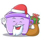 Santa with gift rice cooker character cartoon. Vector Royalty Free Stock Image