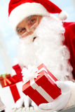 Santa with giftbox Stock Photography