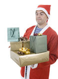 Santa gifts. Young man with santa hat holding some gifts, isolated Stock Photography