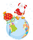 Santa with gifts on a globe Stock Images