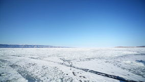 Santa with Gifts goes into the distance. Travel Santa on Lake Baikal stock video footage