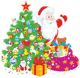 Santa with gifts Stock Images