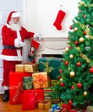 Santa with gifts and the tree Stock Photography
