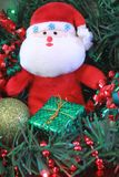 Santa and gifts under tree Royalty Free Stock Images