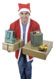 Santa gifts. Young man with santa hat holding some gifts, isolated Stock Photo