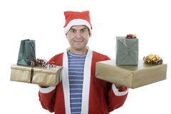 Santa gifts. Young man with santa hat holding some gifts, isolated Stock Photos