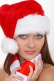 Santa girl. The beautiful girl in a christmas red cap Royalty Free Stock Photos