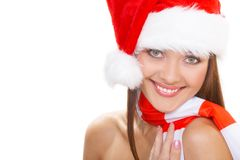 Santa girl. The christmas girl in a red cap Royalty Free Stock Photo