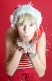 Santa girl. With snow on her hands Stock Photography