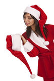 Santa girl appeal to xmas hat. Cheery Santa girl appeal to xmas hat over white background Stock Photography