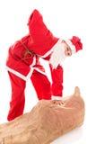 Santa Girl avec le mal de dos par trop se présente, d'isolement dessus Photographie stock