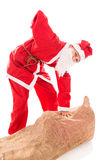 Santa Girl with Backache through too much presents, isolated on. White background Stock Photography