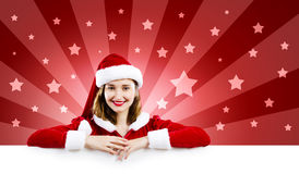 Santa girl with banner Royalty Free Stock Photos
