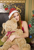 Santa girl with bear Royalty Free Stock Photography