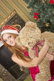 Santa girl with bear Stock Image