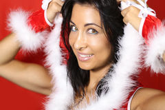 Santa girl. Beautiful girl wearing santa claus clothes stock photos