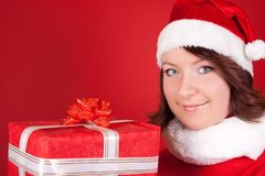 Santa girl with a big present Stock Images