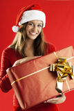 Santa Girl with a big present Royalty Free Stock Photos