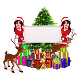 Santa girl with a big sign and christmas tree Royalty Free Stock Photos