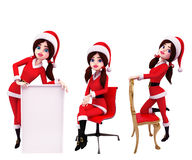 Santa Girl with Big Sign Royalty Free Stock Image