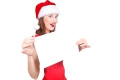 Santa girl with blank banner in hands Royalty Free Stock Photography
