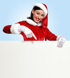 Santa girl with a blank banner Royalty Free Stock Photo