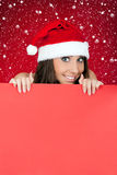 Santa girl and blank billboard Royalty Free Stock Photography