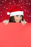 Santa girl and blank billboard Royalty Free Stock Photography