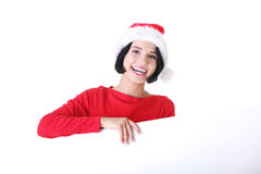 Santa girl with blank board Royalty Free Stock Photos