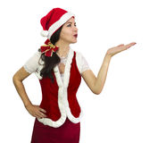Santa girl blowing a kiss Royalty Free Stock Photos