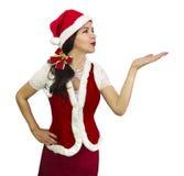 Santa girl blowing a kiss Royalty Free Stock Photos