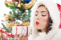 Santa girl blowing snow Royalty Free Stock Image